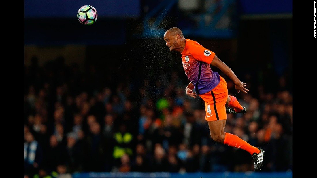 Manchester City captain Vincent Kompany heads the ball during a Premier League match in London on Wednesday, April 5. He was returning from injury to make his first start in months.