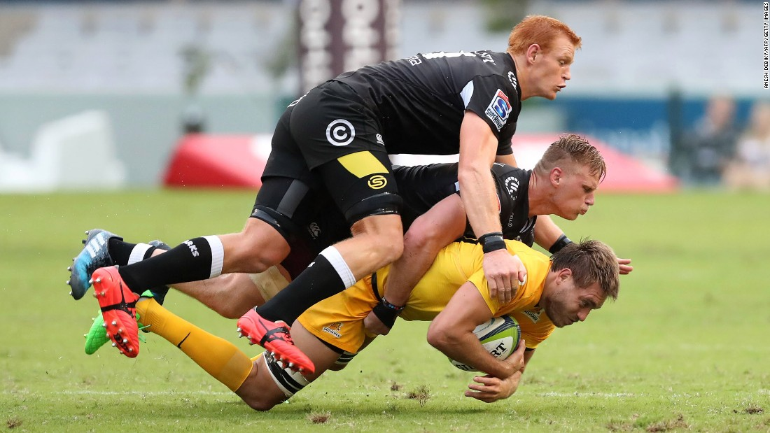 Rodrigo Baez is tackled by Philip van der Walt, top, and Jean-Luc du Preez during a Super Rugby match in Durban, South Africa, on Saturday, April 8. Baez plays for the Argentinean club Jaguares. His opponents play for the Sharks, who are based in Durban.