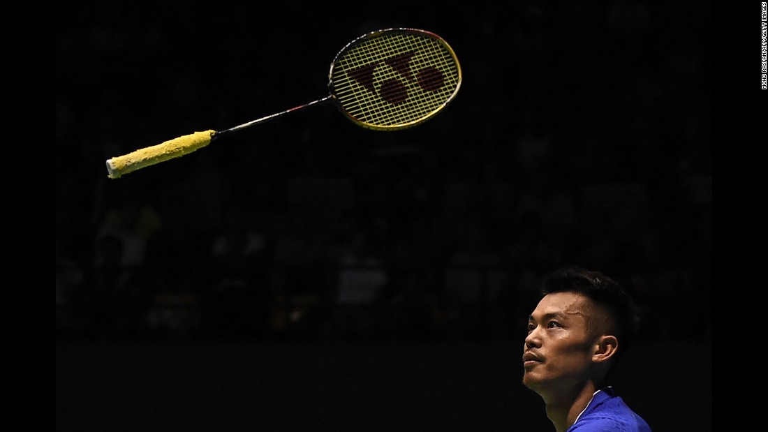 Lin Dan throws his racket during a semifinal match at the Malaysia Open on Saturday, April 8. He would go on to win the badminton tournament.