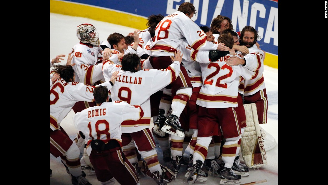 Hockey players from the University of Denver celebrate after winning the NCAA title on Saturday, April 8. The Pioneers defeated Minnesota-Duluth 3-2 to capture their first championship since 2005.