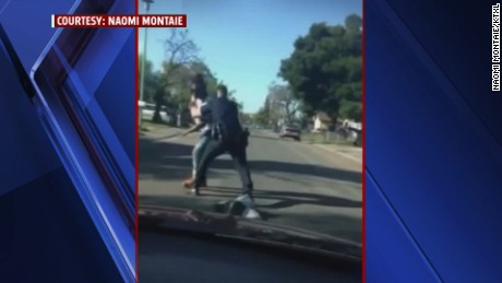 Officer tackles accused  jaywalker to the ground