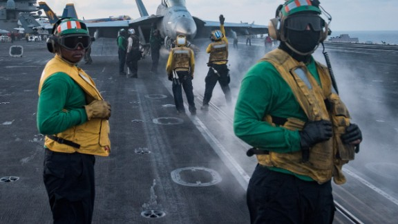 170408-N-HD638-245 SOUTH CHINA SEA (April 8, 2017) Sailors conduct flight operations on the aircraft carrier USS Carl Vinson (CVN 70) flight deck. The Carl Vinson Carrier Strike Group is on a regularly scheduled Western Pacific deployment as part of the U.S. Pacific Fleet-led initiative to extend the command and control functions of U.S. 3rd Fleet. U.S Navy aircraft carrier strike groups have patrolled the Indo-Asia-Pacific regularly and routinely for more than 70 years. (U.S. Navy photo by Mass Communication Specialist 3rd Class Matt Brown/Released)
