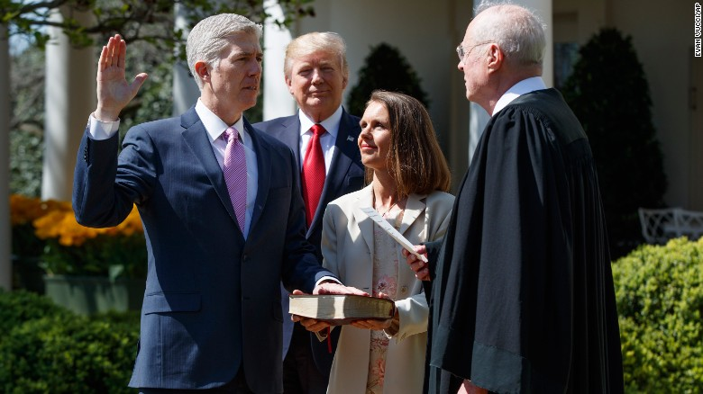 "President Donald Trump watches as Supreme Court Justice Anthony Kennedy, right, administers the judicial oath to Neil Gorsuch during <a href=""http://www.cnn.com/2017/04/10/politics/neil-gorsuch-trump/"" target=""_blank"">a White House ceremony</a> on Monday, April 10. Gorsuch was chosen by Trump to replace Supreme Court Justice Antonin Scalia, who died in 2016. Holding the Bible is Gorsuch's wife, Marie Louise."