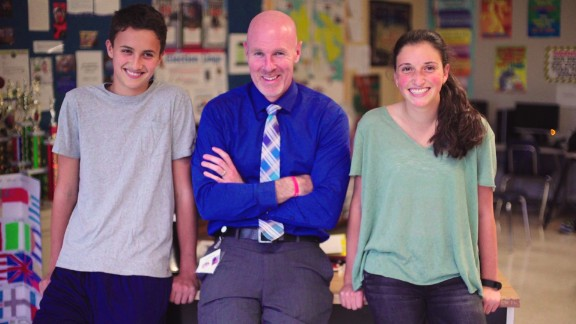 Teacher Brian O'Conner with two former students who were inspired by CNN Heroes.