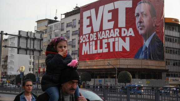 "Istanbul residents walk past ""Yes"" campaign signs in the city center on Saturday, April 8, 2017.  President Tayyip Erdogan's ""Yes"" campaign slogan reads: ""Yes. The people have the freedom to speak and decide."" Large banners reading ""Evet,"" or ""Yes"" can be seen on virtually every corner of the city."