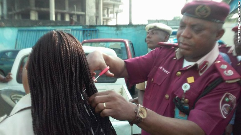 Nigerian Official Cuts Off Female Employees Hair Extensions Cnn