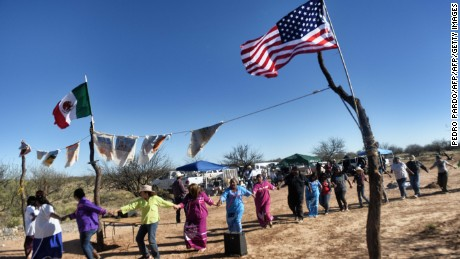 Indigenous people from the Tohono O'odham ethnic group dance and sing to protest against US President Donald Trump's intention to build a new wall in the border between Mexico and United States, on March 25, 2017, in the Altar desert, in Sonora, in the border with Arizona, northern Mexico. / AFP PHOTO / PEDRO PARDO        (Photo credit should read PEDRO PARDO/AFP/Getty Images)
