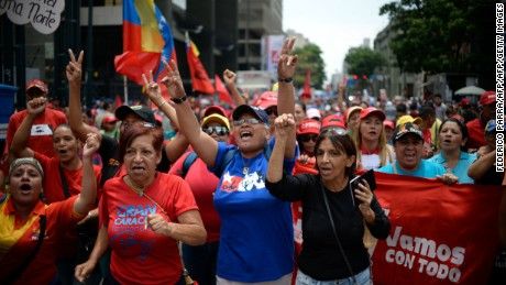 Supporters of Venezuelan President Nicolas Maduro take part in a rally to commemorate 15 years of the coup that briefly removed from power the late president Hugo Chavez, in Caracas on April 11, 2017. This last week has been marked by street protests called by opponents who want to remove Maduro from office over an economic crisis marked by severe shortages and the world's highest rate of inflation. / AFP PHOTO / FEDERICO PARRA        (Photo credit should read FEDERICO PARRA/AFP/Getty Images)