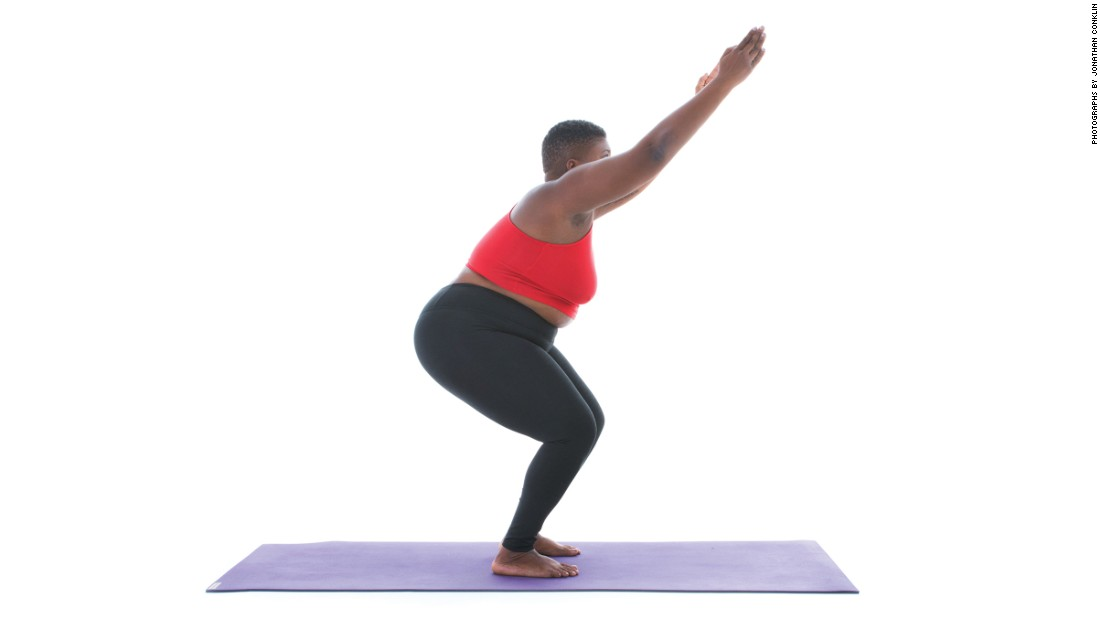 "<strong>Chair pose: Utkatasana</strong> The goal of chair pose, Stanley writes, is to get your thighs parallel to the ground. However, ""don't stress yourself too much if it's too much fire for you.""<br />"