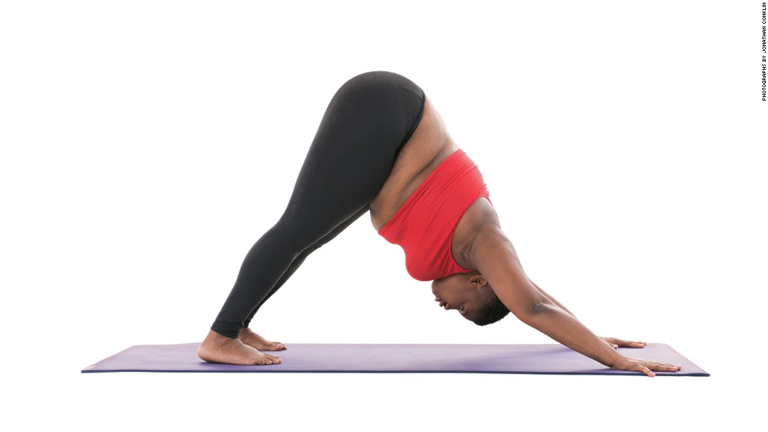 "<strong>Downward-facing dog: Adho Mukha Svanasana</strong> One of the poses most widely associated with yoga, downward-facing dog can also be done with modifications for comfort including adding two blocks under your hands. In the unmodified version, Stanley says, ""Keep a bend in your knees if necessary. Keep shooting your hips up and back. Distribute your weight evenly though your entire hand, including the fingertips.""<br />"
