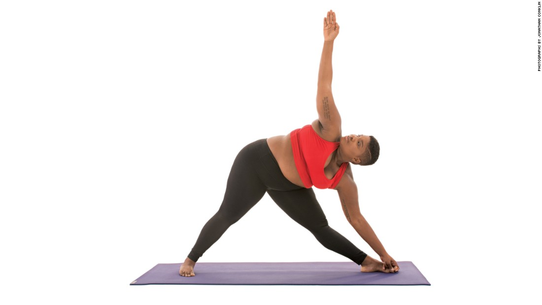 "<strong>Extended triangle: Utthita Trikonasana</strong> This pose can also be modified with a block under the hand closest to the floor if you cannot reach all the way to the ground. Stanley says, ""Keep a microbend in your front knee"" and suggests that you ""look up or down depending on your mood."""