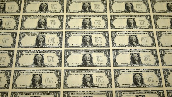 A sheet of freshly printed one dollar bills is ready for inspection at the Bureau of Engraving and Printing on March 24, 2015  in Washington, DC.