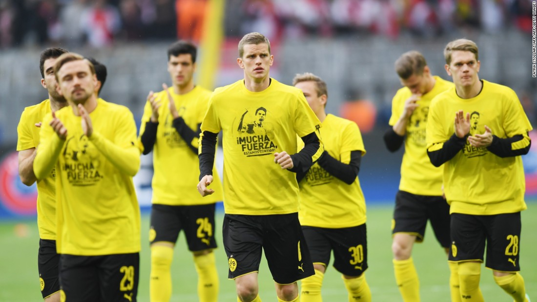 Showing support. Dortmund´s players wore T-shirts with 'Mucha Fuerza' (A lot of strength) and a picture of teammate Marc Bartra -- injured in the bomb attack on Dortmund's team bus -- on the front.