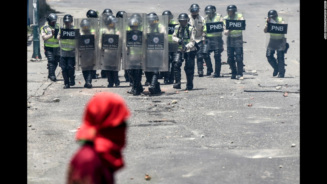 Venezuelan police line up before clashing with opposition activists on Thursday, April 6.