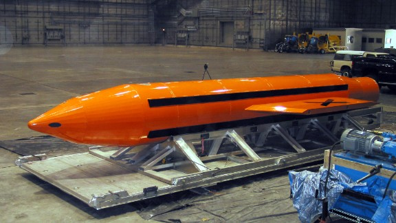 A Massive Ordnance Air Blast weapon is prepared for testing on March 11, 2003. | DoD handout
