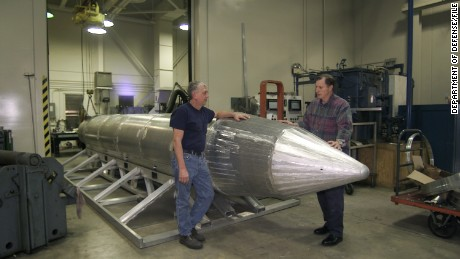 Al Weimorts (left), the creator of the GBU-43/B Massive Ordnance Air Blast bomb, and Joseph Fellenz, lead model maker, look over the prototype of the bomb before it was painted and tested. (Courtesy photo)