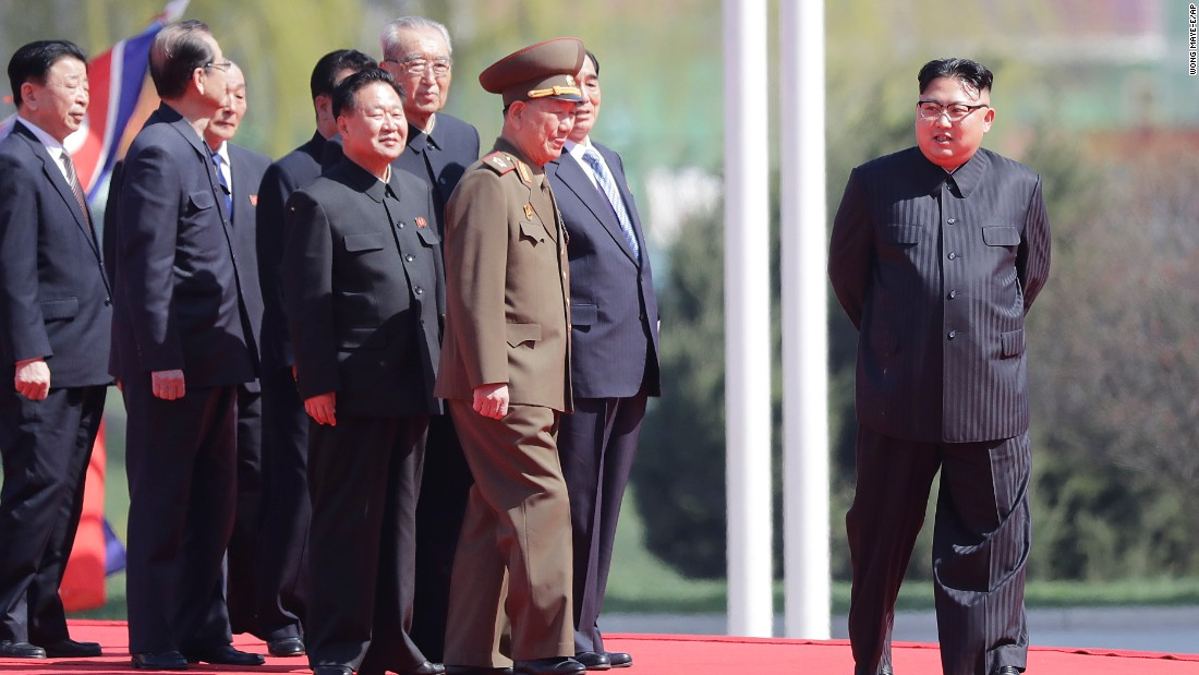 North Korean leader Kim Jong Un is seen on stage.