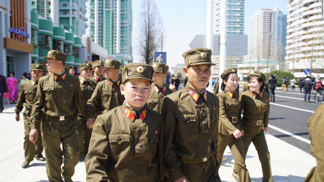 Soldiers leave the opening ceremony of the Ryomyong Street development.