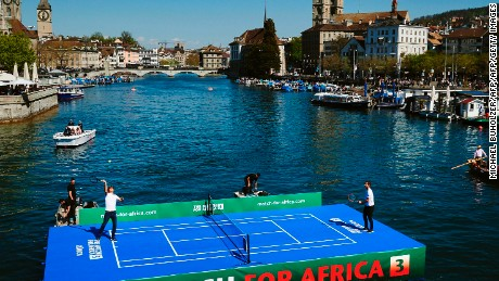 Roger Federer (L) plays world No.1 Andy Murray on a floating tennis court before the pair prepared to play each other in 'Match for Africa 3' to raise money for the Swiss' foundation.