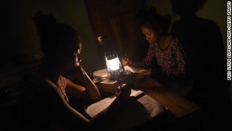Students study with a kerosene lamp due to epileptic public power supply in Lagos on September 24, 2016. Even at the best of times Nigeria, which is home to more than 170 million people, ranks among the lowest countries in the world for energy consumption at just 155 kilowatt hours per person. Between 8,000 and 9,000 MW is the bare minimum considered necessary for Lagos' economy to function. But the megacity only gets about 10 percent of what it needs, leaving its 20 million or so inhabitants to their own devices.