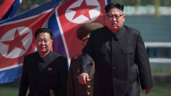 North Korean leader Kim Jong-Un (R) arrives flanked by vice-chairman of the State Affairs Commission Choe Yong-Hae (L) at an opening ceremony for 'Rymoyong street', a new housing development in Pyongyang, on April 13, 2017.