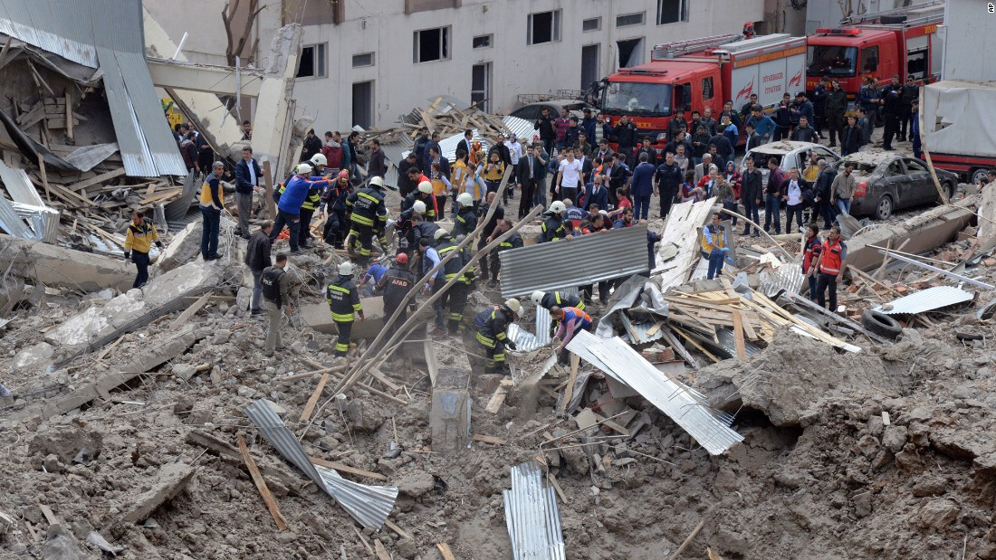 "Rescue workers gather at a police station in Diyarbakir, Turkey, where <a href=""http://www.cnn.com/2017/04/12/world/turkey-police-station-blast/"" target=""_blank"">an explosion</a> killed at least three people and injured at least 10 on Tuesday, April 11. A Turkish official called it a ""terror incident."""