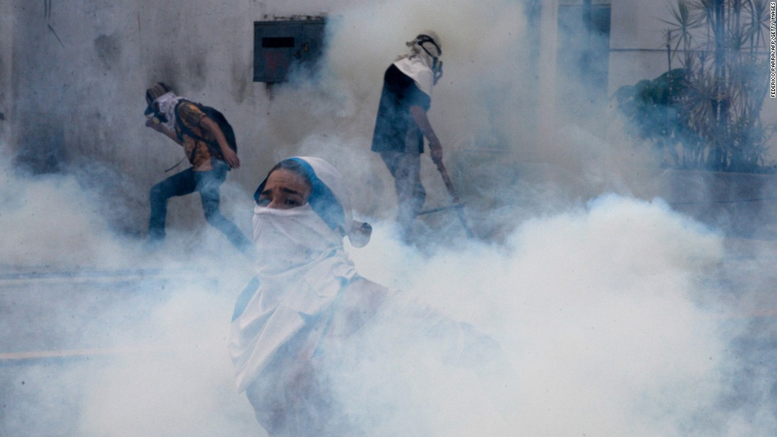 "Tear gas engulfs people in Caracas, Venezuela, as they protest against the Venezuelan government on Monday, April 10. Last month, the Venezuelan Supreme Court <a href=""http://www.cnn.com/2017/03/30/americas/venezuela-dissolves-national-assembly/"" target=""_blank"">stripped the country's National Assembly of its powers.</a> The National Assembly, Venezuela's legislative body, has had an opposition majority since January 2016."