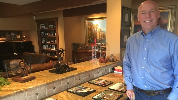 Greg Gianforte, the Republican candidate for Congress shows some old family photos of camping in the backcountry in his home in Bozeman.