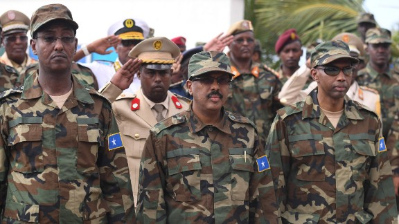 The president of Somalia, Mohamed Abdullahi Mohamed Farmaajo (center), receives a guard of honor during a ceremony to mark the 57th Anniversary of the Somali National Army held at the Ministry of Defense in Mogadishu on Wednesday, April 12, 2017.