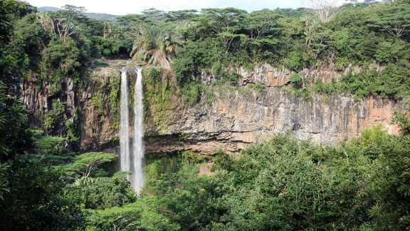 <strong>Chamarel waterfall:</strong><strong> </strong>Chamarel is also where a narrow waterfall plunges over a cliff. The Black River Gorges National Park nearby protects what remains of the island's original rainforest.