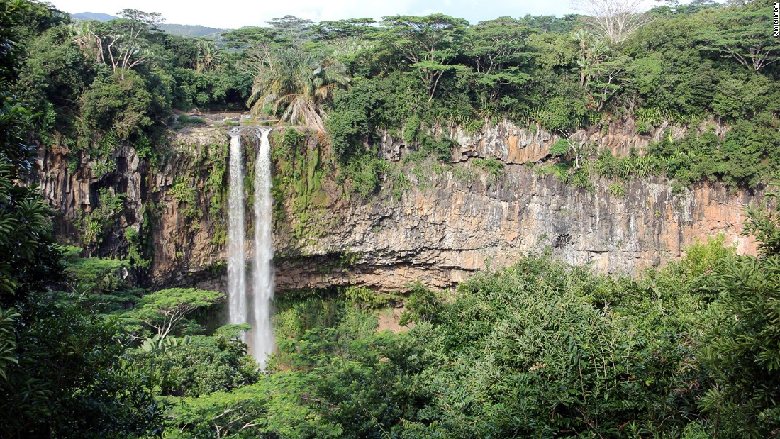 <strong>Chamarel waterfall -- </strong>Chamarel is also where a narrow waterfall plunges over a cliff. The Black River Gorges National Park nearby protects what remains of the island's original rainforest.