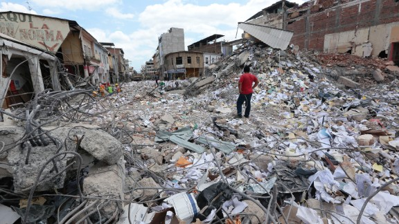 A man surveyes the rubble in Portoviejo, Ecuador, after a 2016 earthquake killed more than 650 people.