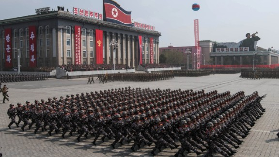 Korean People's Army soldiers march on Kim Il-Sung square.