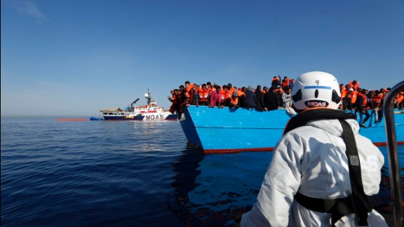 Ships from the humanitarian organization Migrant Offshore Aid Station approach a boat migrants in the middle of the Mediterranean Sea on April 15.
