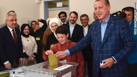 Turkish President Recep Tayyip Erdogan (R) casts his vote accompanied by his wife Emine Erdogan (3rd R) and their grandchildren during the referendum on expanding the powers of the president at a polling station in the Uskudar district of Istanbul, on April 16, 2017. Erdogan said the tightly-contested referendum on expanding the powers of the head of state was a vote for the future of Turkey. The first polling stations opened in the tightly contested referendum on expanding the powers of the president, seen as a crossroads in the modern history of the country.  / AFP PHOTO / OZAN KOSE        (Photo credit should read OZAN KOSE/AFP/Getty Images)