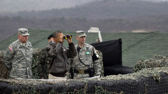 US President Barack Obama looks toward North Korea from Observation Post Ouellette during a visit to the DMZ on March 25, 2012. Obama arrived in Seoul earlier in the day to attend the Seoul Nuclear Security Summit.