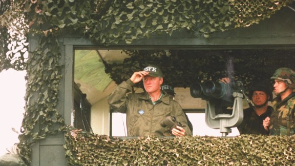 US President Bill Clinton surveys the North Korean border on his tour of the DMZ during a post-G7 summit trip in July 1993.