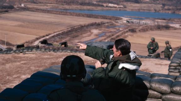 US President Ronald Reagan looks across the DMZ at Guard Post Collier, South Korea, on November 13, 1982.