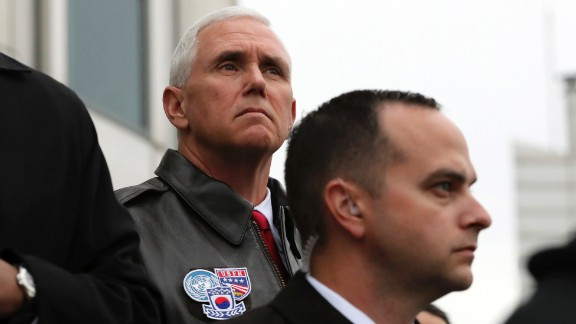 US Vice President Mike Pence looks at North Korea from the border village of Panmunjom on April 17, 2017. Pence visited a military base near the Demilitarized Zone, a day after the North conducted a failed missile launch. Pence arrived at Camp Bonifas on Monday for a briefing with military leaders and to meet with American troops. He is in South Korea as part of a 10-day tour of Asia.