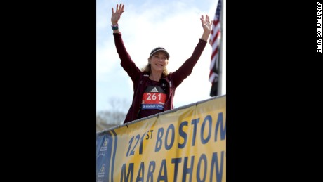 Switzer greets the Boston Marathon crowd Monday before the start of the women's elite division.