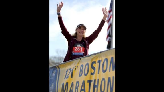 Switzer greets the Boston Marathon crowd Monday before the start of the women's elite division.