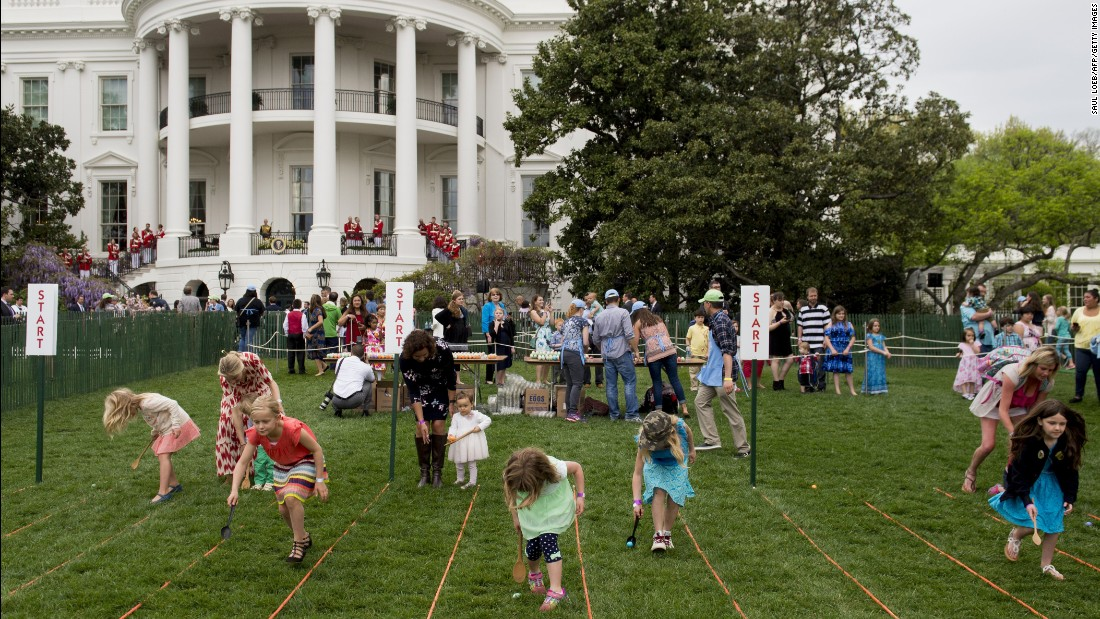 Children on the South Lawn participating in an Easter egg race.