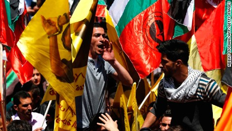 Protesters show their support for jailed Palestinians in a rally in Ramallah Monday.