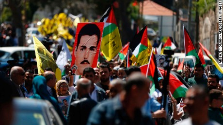 Protesters rally in Ramallah on Monday.