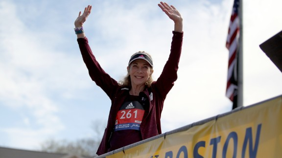 Kathrine Switzer, who was the first official woman entrant in the Boston Marathon 50 years ago, acknowledges the crowd as she is introduced before firing the gun to start the women's elite division at the start of the 2017 Boston Marathon.