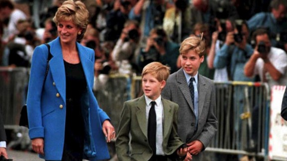 Prince Harry photographed with Princess Diana and Prince William.