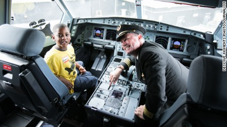 Nathaniel Underwood, 5, sits in the cockpit of a Delta Airbus A320  with Captain Erich Ries.