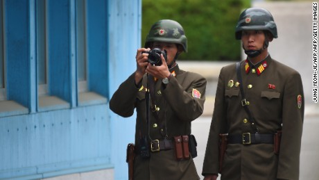 A North Korean soldier takes a photo during US Vice President Mike Pence's visit to the Demilitarized Zone (DMZ), April 17.