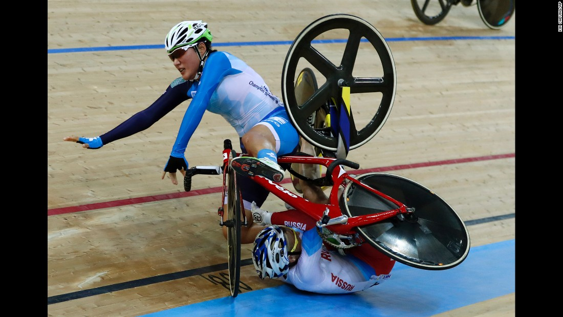 Hong Kong's Pang Yao, left, and Russia's Maria Averina collide during the madison at the Track Cycling World Championships in Hong Kong on Saturday, April 15.