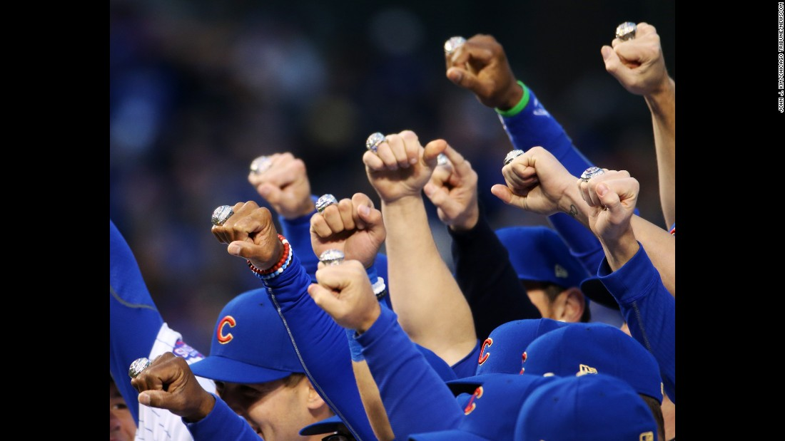 Chicago Cubs players pose with their World Series rings before a home game against Los Angeles on Wednesday, April 12. The ceremony Wednesday night commemorated Chicago's 2016 World Series win.